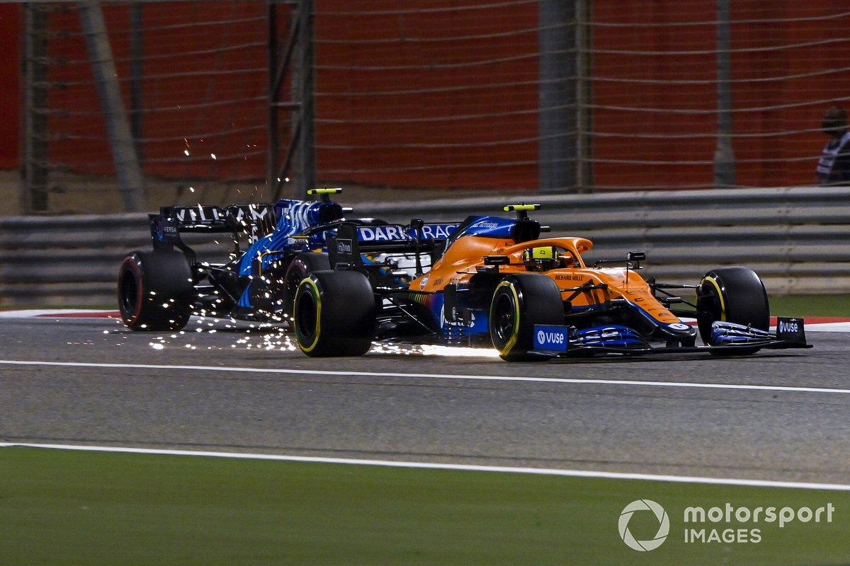 Lando Norris, McLaren MCL35M, Nicholas Latifi, Williams FW43B, as sparks fly