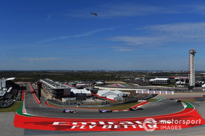Antonio Giovinazzi, Alfa Romeo Racing C38, leads Lance Stroll, Racing Point RP19, and Sergio Perez, Racing Point RP19