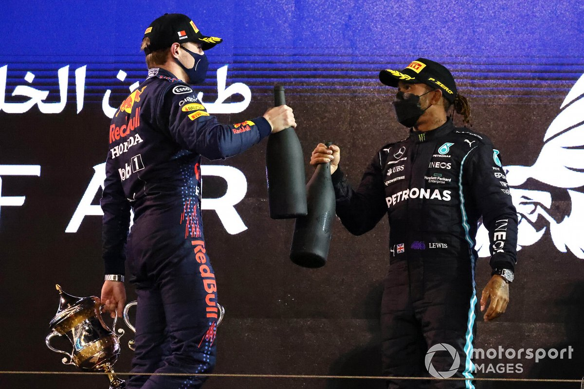 Max Verstappen, Red Bull Racing, 2nd position, and Lewis Hamilton, Mercedes, 1st position, on the podium