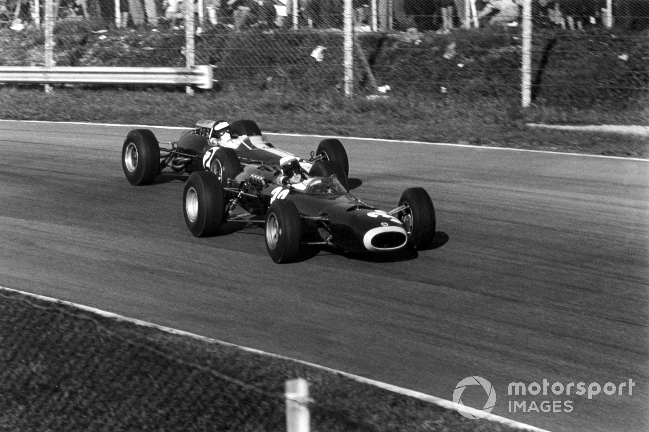 Jackie Stewart, BRM P261, leads Jim Clark, Lotus 33-Climax at the 1965 Italian Grand Prix