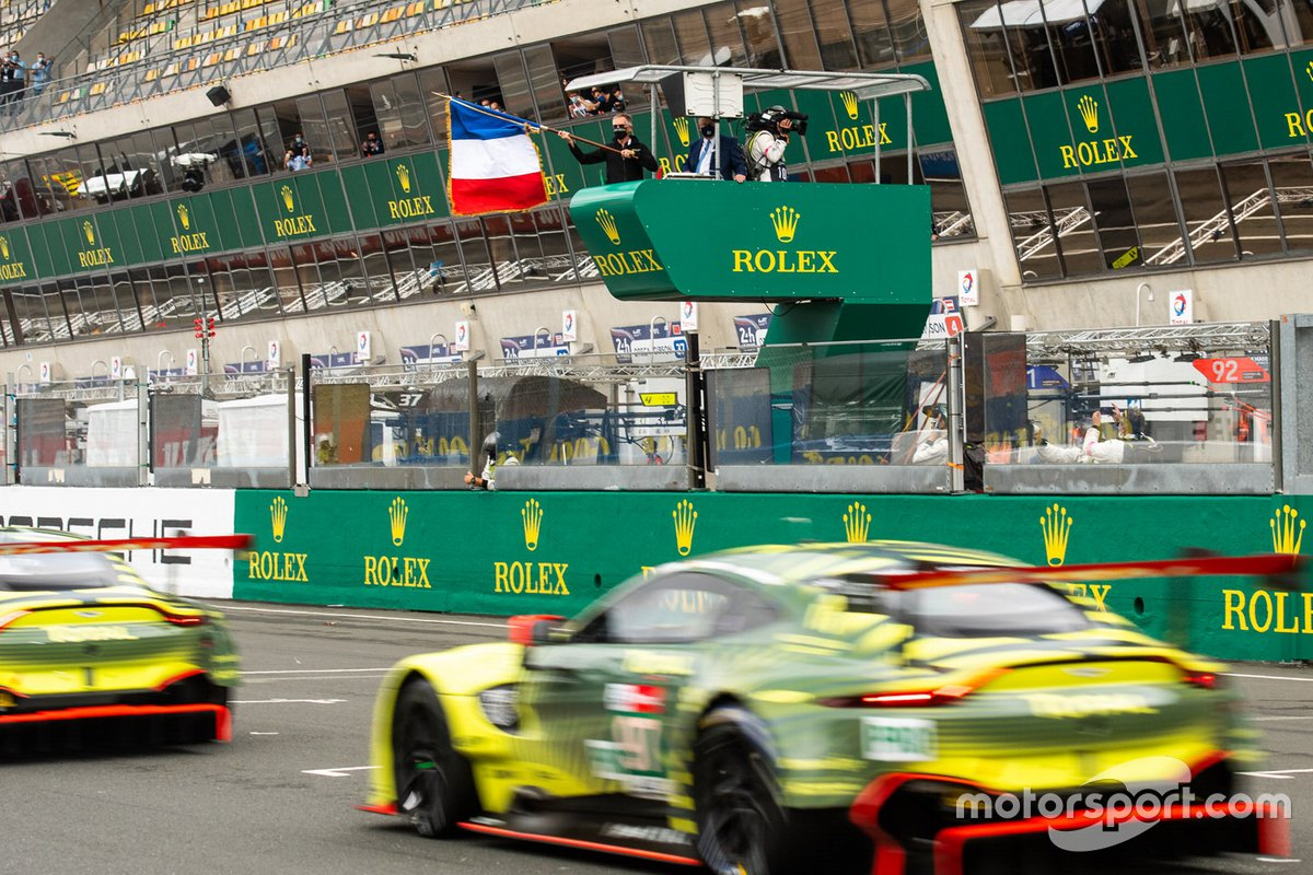 Carlos Tavares waves the 24 Hours of Le Mans starter's flag
