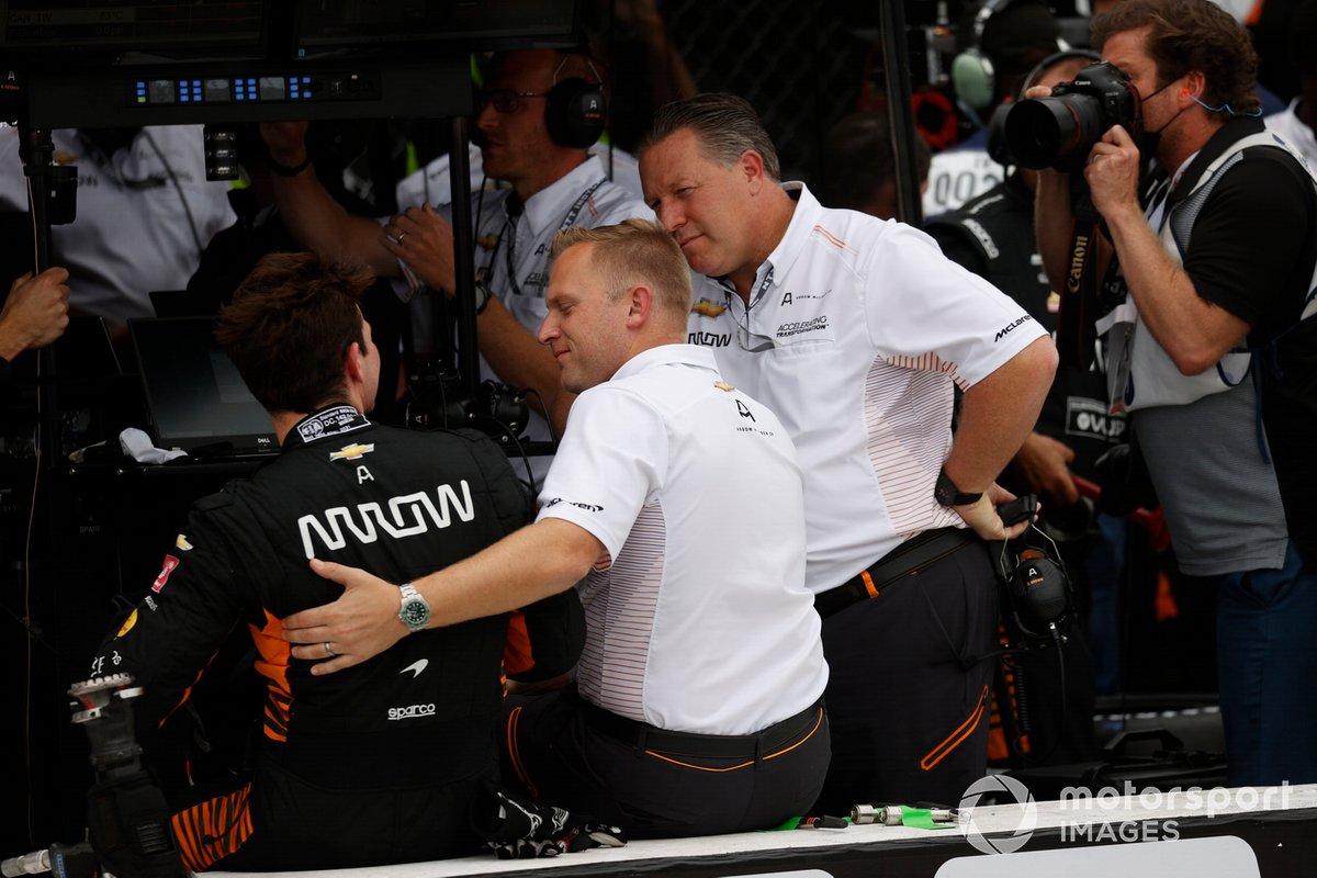 Patricio O'Ward with Arrow McLaren SP president Taylor Kiel and Zak Brown.