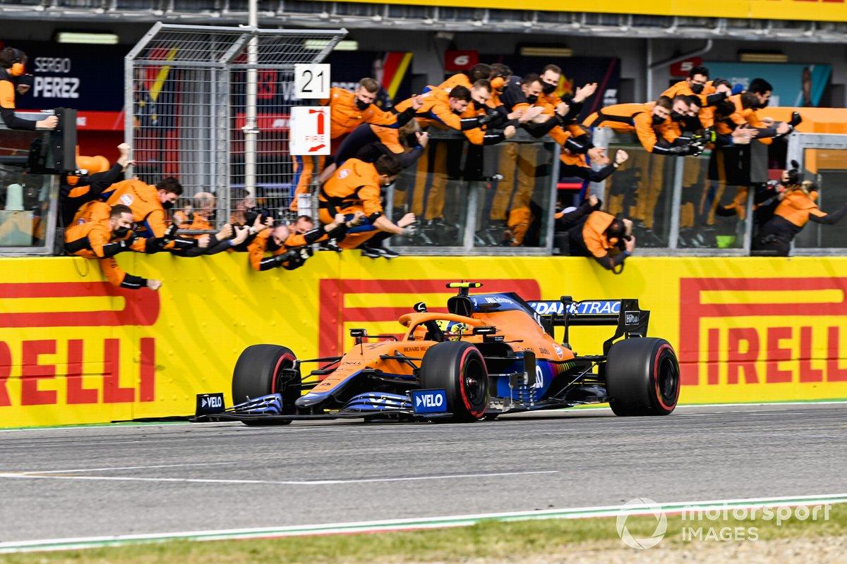 Lando Norris, McLaren MCL35M crosses the finish line