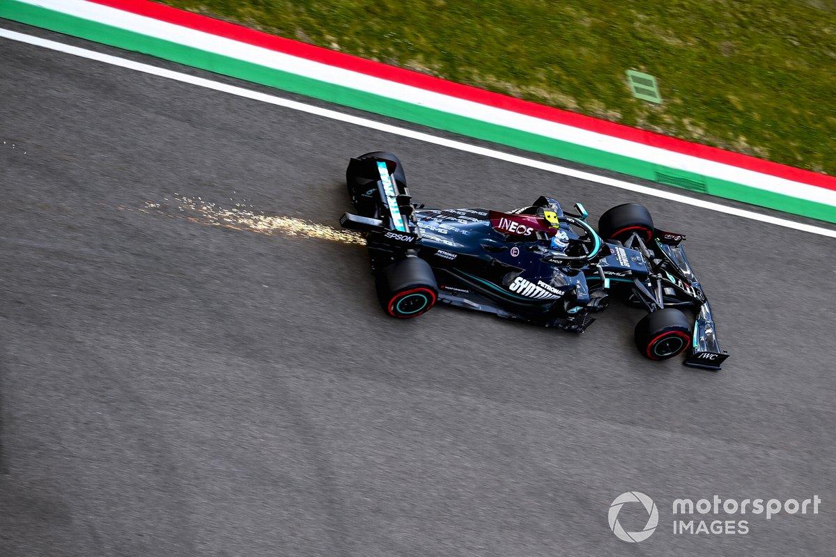 Sparks trail behind Valtteri Bottas, Mercedes W12